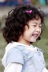 young Asian girl laughing