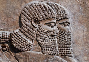 ancient carving of two Assyrian warriors